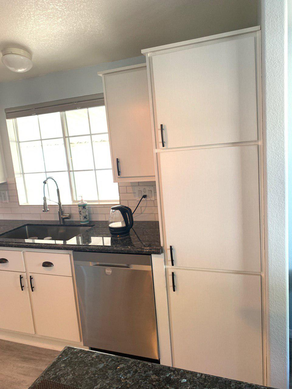 cabinet refacing with black counter top